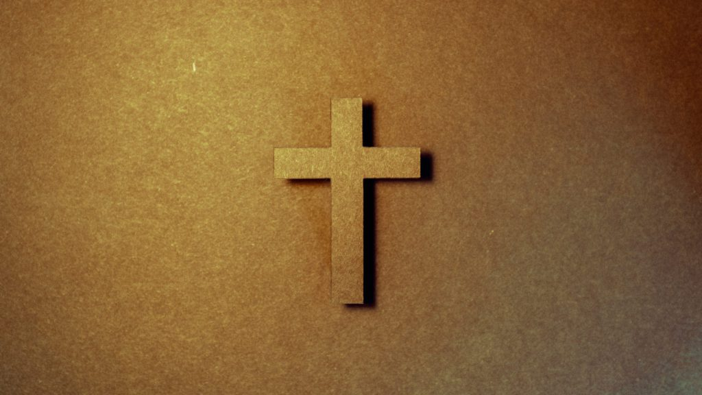Cross against a brown background for Good Friday