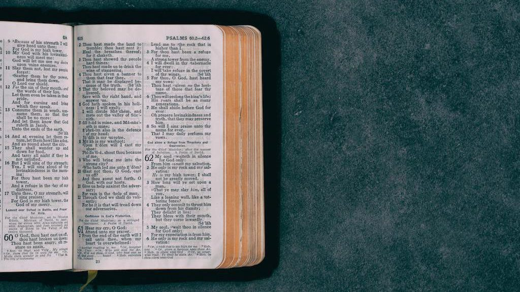 Open bible on colorful background