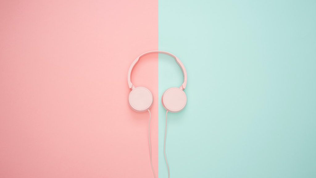Headphones laying on colorful background